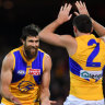West Coast's Josh Kennedy and Jake Waterman celebrate a goal during the match against the Crows in Adelaide.
