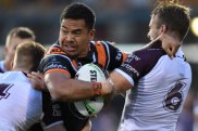 Running strong: Esan Marsters muscles up in attack in the win over Manly last week.
