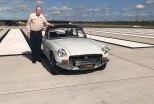 John Hansford with his 1972 MGB sports car at Brisbane Airport.