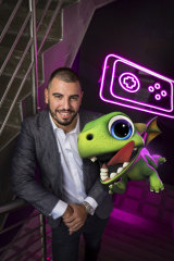 Gerry Sakkas of PlaySide studios with an augmented reality dragon from AR Dragon.