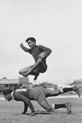 Player Mervyn William's brother Mick, 18, shows at practice the way he leaps over a tackling player.One of the images found in the lost archive.