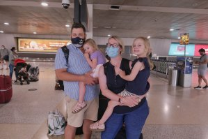 Qantas passengers Jen and Dan, with children Pippa and Tilda, arrive in Melbourne from Queensland on Friday.