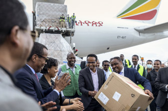 Ethiopia's national coronavirus co-ordinator, Dr Shumete Gizaw (centre right) with medical supplies from a shipment sent to Addis Ababa on Sunday.