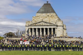 Police respond to protests by construction workers at the Shrine of Remembrance today.