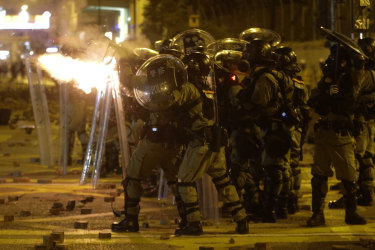 Police seize roads in wake of cannon, arrow and catapult clashes in Hong Kong