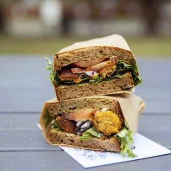 Falafel and pesto sandwich, piled on rich brown bread.