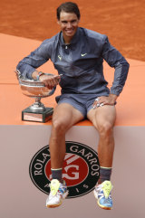 Rafa's dozen: Nadal poses with the French Open trophy after beating Dominic Thiem in the final.