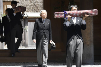 Akihito, centre, visits Ise Grand Shrine in April to inform the gods of his abdication.