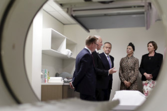 Labor leader Bill Shorten (centre) with Labor's candidate for Bennelong, Dr Brian Owler, Dr Michael Lannan, cancer patient Susie Sumner and shadow health minister Catherine King at a diagnostic imaging centre in NSW in April.