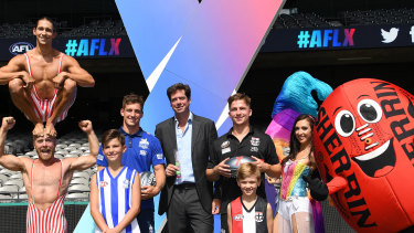 Bring on the circus: AFL boss Gillon McLachlan, centre, has hit on a marketing coup.