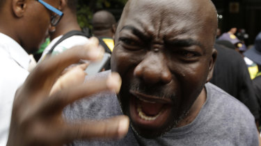 A member of the African National Congress  protesting against President Jacob Zuma outside the party's headquarters in downtown Johannesburg on Monday.