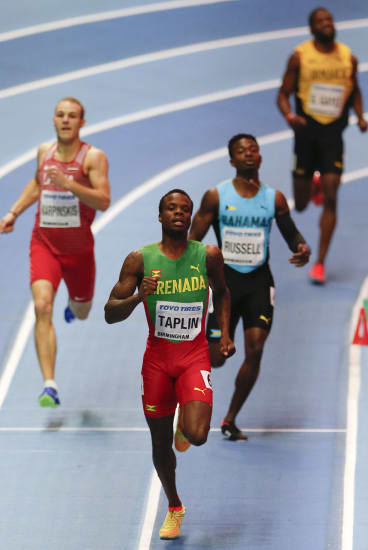Cooled off: Grenada's Bralon Taplin leads in a men's 400 metre heat at the World Athletics Indoor Championships in Birmingham.
