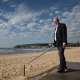 "Bruce Baird metres from his home on Manly Beach near the Queenscliff end. The former NSW tourism minister has a ""gut feeling"" that domestic tourism will rebound to 75 per cent by December."