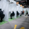 Berliners stay distanced at a vaccine centre.
