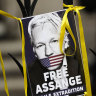 A poster of Julian Assange is attached to the gate at the entrance the High Court in London on Wednesday.