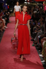 A red version of the shirt dress Meghan Markle wore on the afternoon of the first day of the tour on the runway at the Brandon Maxwell show at New York Fashion Week in September.