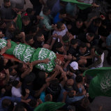 Palestinian mourners carry the body of Nidal Safadi, who was killed in clashes with Israeli forces, during his funeral in the West Bank village of Urif, near Nablus, on Friday.