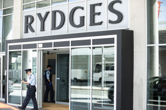 Federal police officers outside the Rydges Sydney Airport hotel, where overseas travellers will be quarantined.
