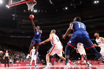 The US' Jrue Holiday drives to the basket against France.