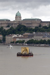 A vessel with a crane approaches the site of the accident.