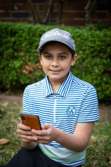Sahara Hillman-Varma using Spriggy, a digital pocket money app.