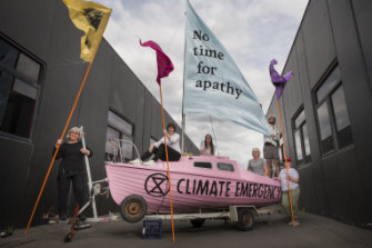 Setting out to protest: Extinction Rebellion protesters prepare props in Thornbury.