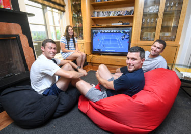 Chilling out: Neal and Ken Skupski (foreground) with siblings Kate and Steve Lustig at rear.