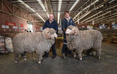 Craig Dewar, left, and son Lachlan Dewar with two of their prized rams.