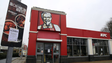 A closed sign is seen outside a KFC restaurant near Ashford, England,