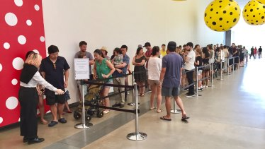 GOMA guests queue to experience 'Yayoi Kusama: Life is the Heart of Rainbow', which runs until February 11.