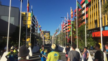 Gold Coast Commonwealth Games staff show guests through the athletes village.
