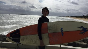 "A ""Groyne Rider"" with his board."