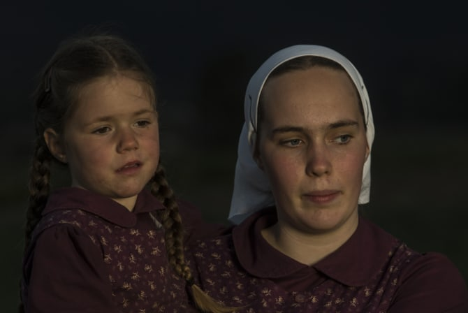 Esther, 17, holds her sister Ruth, 4.