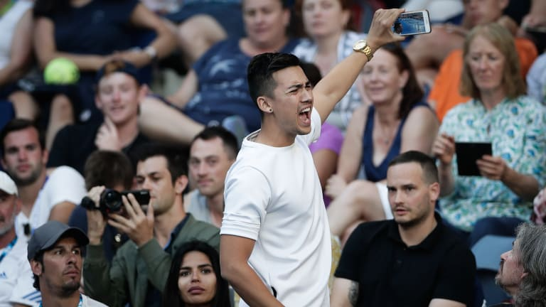 Jamie Zhu, a YouTube prankster, was ejected from Hisense Arena during Nick Kyrgios' second round Australian Open match.
