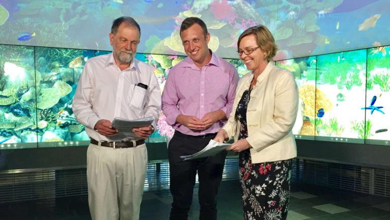 Environment Minister Steven Miles (centre) launches the Great Barrier Reef Report Card 2015-16 with Independent Science Panel chairman Dr Roger Shaw and Terrain NRM CEO Carole Sweatman.