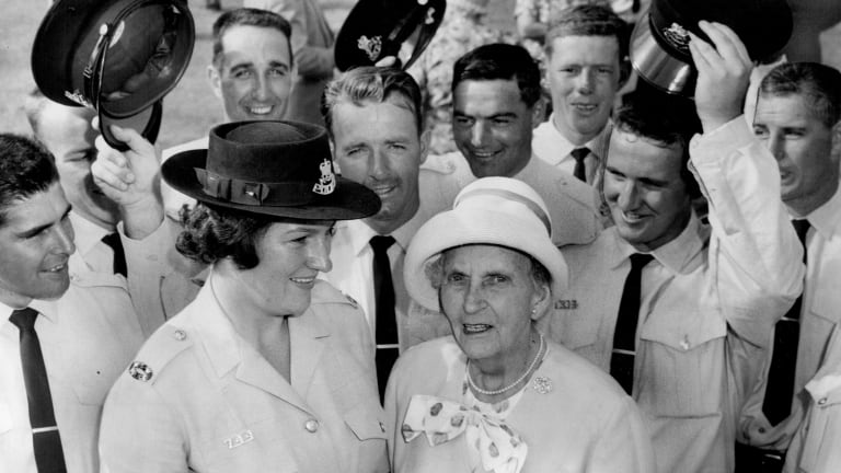 Lillian Armfield, aged 80,  with a group of constables who were sworn in at the passing-out parade in Redfern, in 1964.