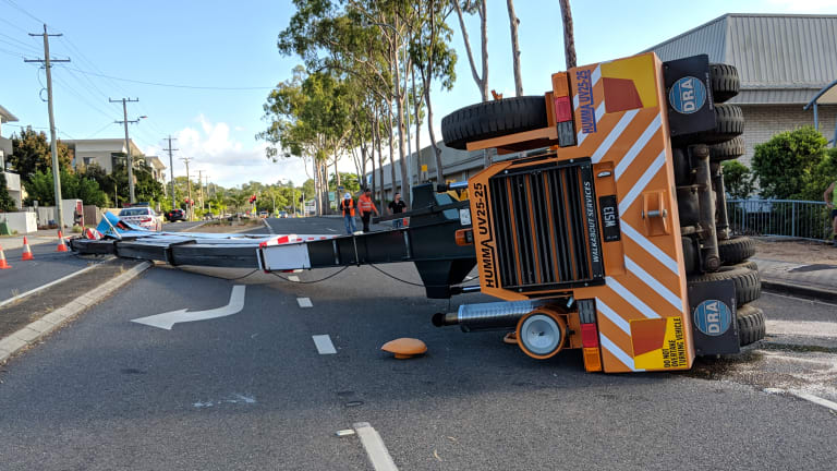 A25-tonne crane came down across the road from a major shopping centre.