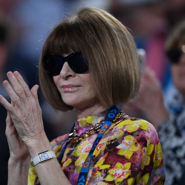 Vogue editor Anna Wintour applauds after watching Serena Williams of the United States defeat Simona Halep of Romania during day eight of the Australian Open tennis tournament in Melbourne.