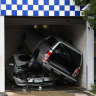Car smashes into Reservoir police station, crushes police car