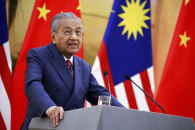 Mahathir speaks to reporters at Beijing's Great Hall of the People during a visit as prime minister three years ago.