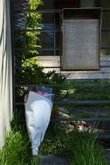 Flowers outside the $6.2m Dover Heights home of Melissa Caddick.