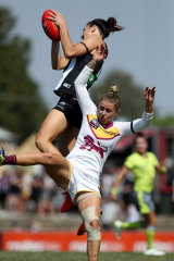 Collingwood's Ash Brazill flies for a mark in the 2019 AFLW season.