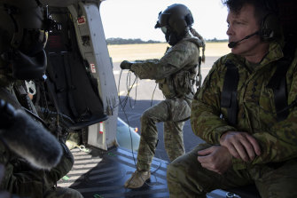 Colonel Warwick Young with ADF personnel prepare to depart Port Macquarie Airport.