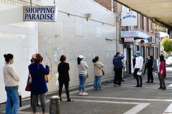 People awaiting Pfizer COVID vaccine shots in Cabramatta.