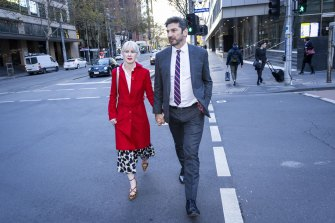 Constantine Arvanitis outside Melbourne's County Court with his fiancee, Melanie Thornton, after the first day of his defamation trial against former partner Selina Holder.