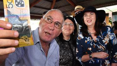 Premier Annastacia Palasczcuk place a Melbourne Cup bet while on the campaign trail.
