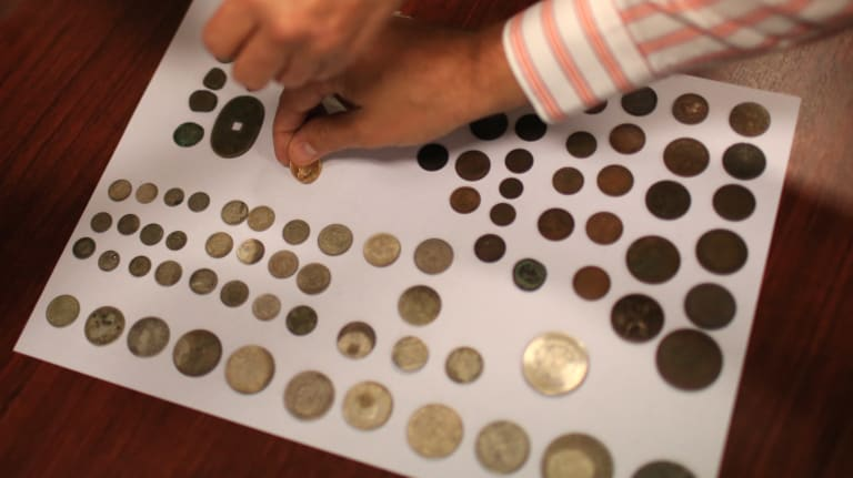 Coins from around the world were found in the time capsule.