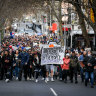 Anti-lockdown protesters march through central Melbourne on July 24.
