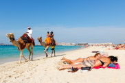 Tourists on beach in Dubai.