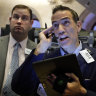 Wobbly day on Wall Street ends mixed